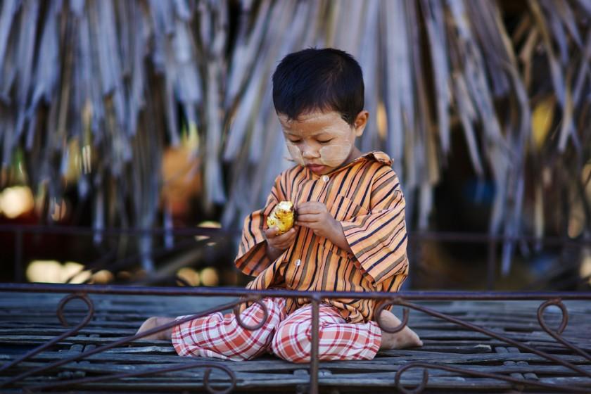 Burmese child with thanaka in small village, Bagan, Burma